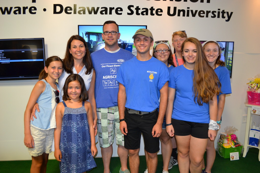 Middletown FFA advisor Jeff Billings and the rest of the FFA family show their support at the Delaware State Fair for Brandon Dawson $1000 scholarship award from the Delaware Forestry Association.